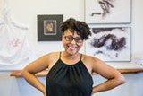 "PHOTO COURTESY ARIAN HORBOVETZ - Amanda Chestnut at her exhibit, ""Good Hair,"" at Genesee Center's Joe Brown Gallery."