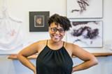 "PHOTO COURTESY ARIAN HORBOVETZ - Amanda Chestnut at her exhibit, ""Good Hair,"" at Genesee Center's Joe Brown Gallery."