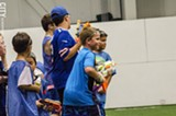 PHOTO BY MARK CHAMBERLIN - Kids line up for foam dart game.