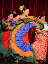 PHOTO BY PECK F. ROARD - Elizabeth Díaz performs a plena -- a folkloric Puerto Rican dance -- during a Hispanic AND Latino Heritage Family Day at the Memorial Art Gallery.