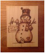 c64d7276_wood_burning_snowman.png