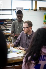 PHOTO BY KEVIN FULLER - Art teacher Geoff Morgan works with students at East High.