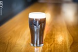 PHOTO BY KEVIN FULLER - The brewery's signature beer is an Irish stout that is made using nitrogen rather than carbon dioxide, creating a smoother, creamier taste.