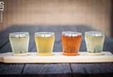 PHOTO BY KEVIN FULLER - A flight of cider at Blue Toad. The cidery sources its ingredients from Schutt's Apple Mill in Webster and The Apple Farm in Victor.