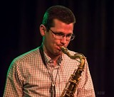 822942ae_doug_playing_sax_headshot.jpg