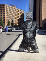 PHOTO COURTESY AX - A stencil and spray paint image of Trump in bondage showed up at various locations around downtown Rochester over the weekend.