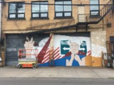 PHOTO BY REBECCA RAFFERTY - Todd Stahl's in-progress mural for WALL\THERAPY 2017 focuses on the Syrian refugee crisis.