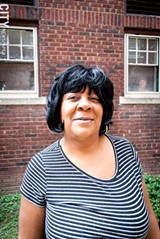 PHOTO BY RYAN WILLIAMSON - Mary Brown, a tenant at 447 Thurston Road, and other people who live in buildings owned by Peter Hungerford have loudly spoken out about the conditions of their apartments.