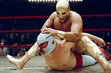"PARAMOUNT PICTURES - Who is that - masked man? Jack Black (bottom) takes on other luchadors - in the new film ""Nacho Libre."""
