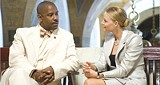 COURTESY UNIVERSAL PICTURES - Who's the man? Oscar winners/snappy - dressers Denzel Washington and Jodie Foster square - off in Inside Man.