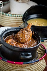 PHOTO BY MARK CHAMBERLIN - Yedoro wat (a drumstick in barbecue sauce with a hard-boiled egg) served with kik alitcha (yellow split peas with onion, herbs, and spices) and injera, from Taste of Ethiopia on State Street.