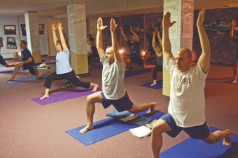 Yoga is taught at many area gyms, including Downtown Fitness Club (pictured). - FILE PHOTO