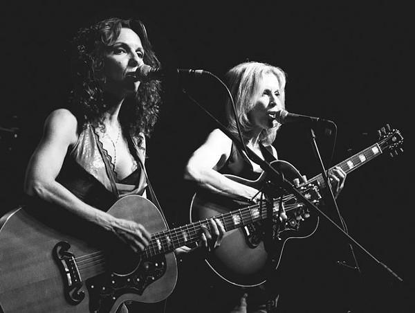 A bittersweet night: Lisa (left) and Roberta Morales rockin' it at Sam's. - FRED JIMENEZ