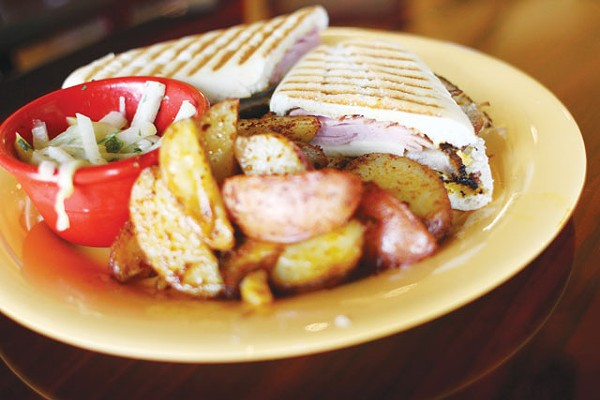 A Cuban panini with baked potato wedges from Calypso. - MICAHEL BARAJAS