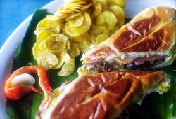 A Cuban sandwich at La Marginal, flanked by plantain chips.