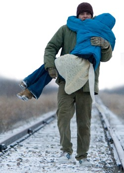A presumably lucid Nick Stahl carries AnnaSophia Robb (again, presumably) down the long and ... undwinding railroad.