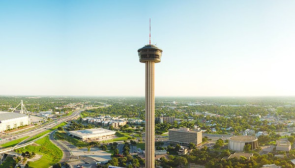 A room with a view and a drink at Tower of the Americas. - COURTESY