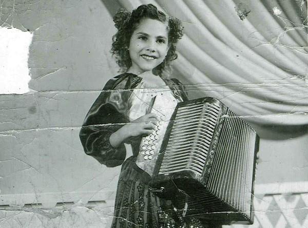 Accordion queen Eva Ybarra as a child. - COURTESY