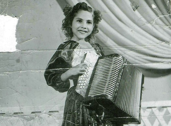 Accordion queen Eva Ybarra as a child. - COURTESY