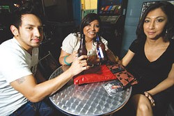 Adrian Torres, Marzella Fela, and Yvonne Valdez enjoy a drink at the Pedicab Bar & Grille.