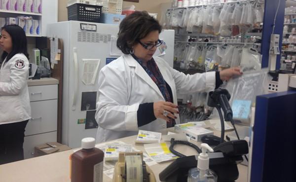 Sen. Leticia Van de Putte begins her shift at Davila Pharmacy off Guadaluipe Street Tuesday. - ALEXA GARCIA-DITTA