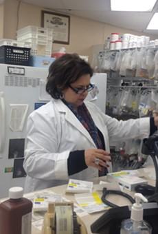 Sen. Leticia Van de Putte begins her shift at Davila Pharmacy off Guadaluipe Street Tuesday.