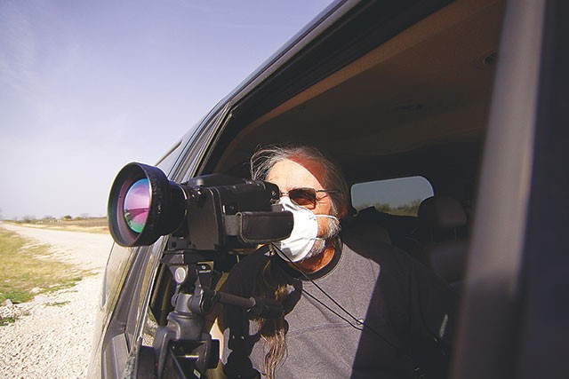 An anti-fracking activist shoots infared video in Karnes County in early March - MICHAEL BARAJAS