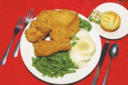 An Earl Abel's boilerplate special: Fried chicken, mashed potatoes and gravy, green beans, and a dinner roll.