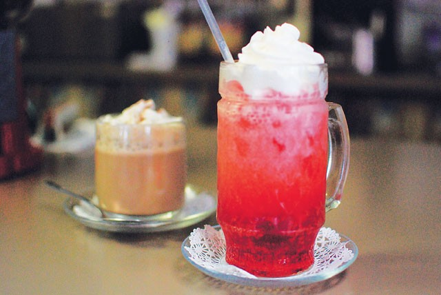 An Italian cream soda and Almond Joy from Buon Giorno Café - SARAH MASPERO