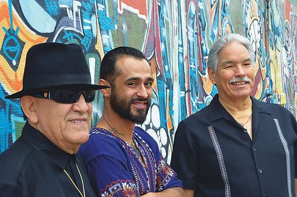 "Arturo ""Sauce"" González, Sam Villela, and Ernie Garibay at the mural near the old Saluté. - SCOTT ANDREWS"