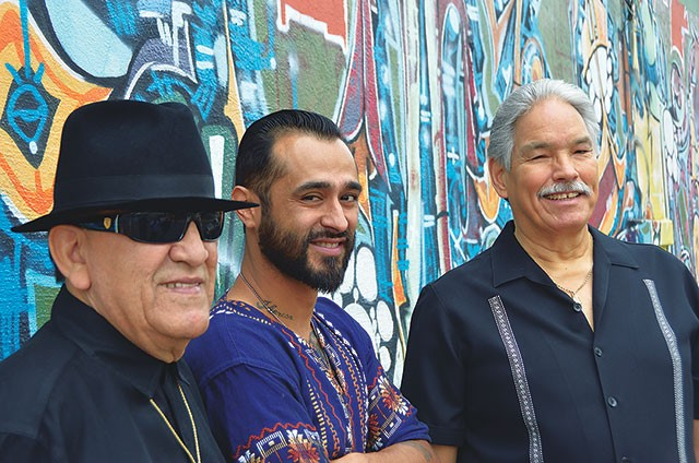 "Arturo ""Sauce"" González, Sam Villela, and Ernie Garibay at the mural near the old Saluté. - SCOTT ANDREWS"