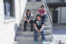 STEPHEN CASTRO - At Jefferson High, on the steps where they had their first photo session as a band called Sublimaze (!). This time, Nina is in the picture.
