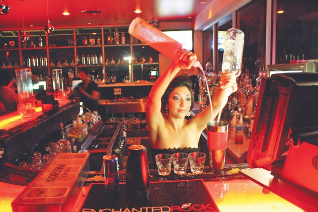Bartender Nicole Gonzalez demonstrates the long pour at Area 31. - VERONICA LUNA