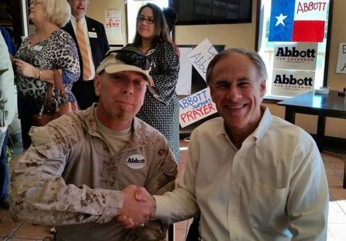 Kevin Lyndel Massey poses with Republican gubernatorial candidate Greg Abbott at an Brownsville campaign event on October 16. - FACEBOOK