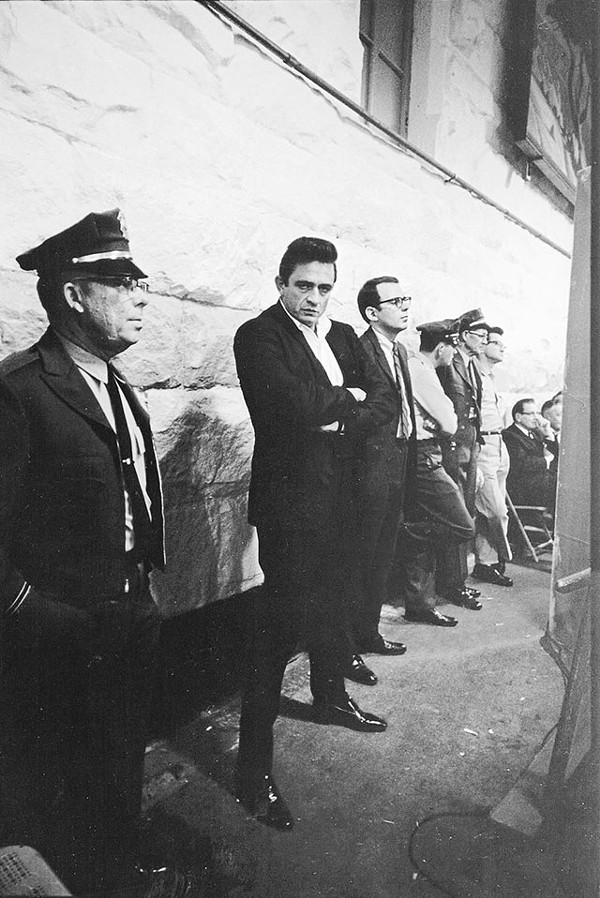 Cash at 1968's historic Folsom Prison concert; to his left, Hilburn, the only music journalist present - JIM MARSHALL