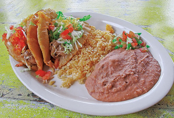 Chicken puffy taco plate with rice and refried beans - JUSTIN PARR