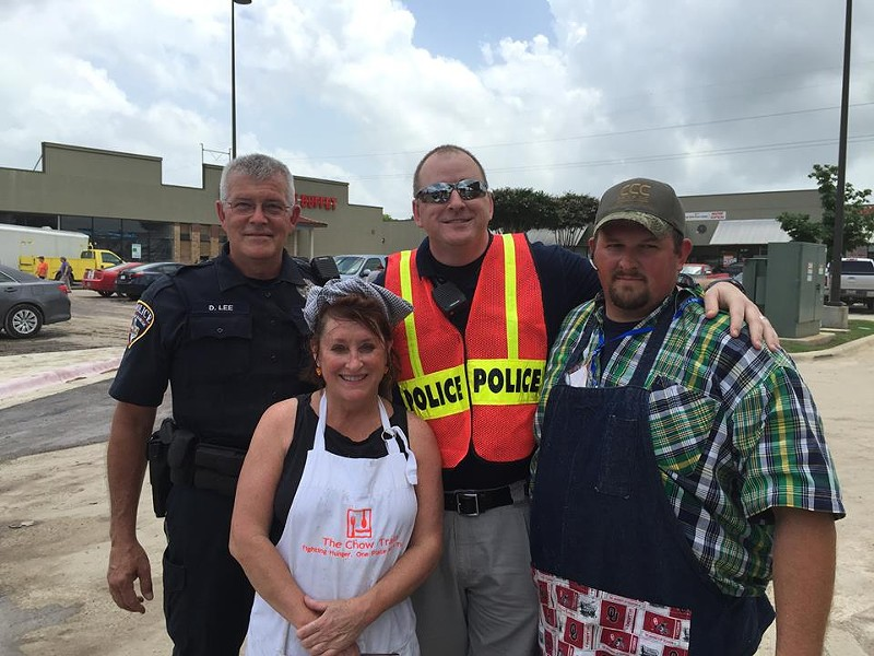 Cheever with volunteer helpers on Tuesday, May 26. The truck was parked next to a heavily hit strip center and neighborhood in San Marcos. - THE CHOW TRAIN/FACEBOOK