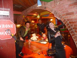 Chris Smart, Florencio Contreras, and Tracy Scarborough succumb to the siren call of the Mine Shaft Saloon, the in-house bar at SA time capsule the Magic Time Machine.