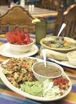 Clockwise from bottom - Chicken Fiesta plate; guacamole salad with chips; and a large bowl of beef caldo served with rice and corn tortillas.