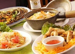 Clockwise from front: Thai spring rolls; green papaya salad; Thai spicy fish and the shrimp clay pot.