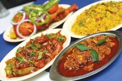 Clockwise from left: Chicken 65, T.D. Chicken, Chicken Biryani, and Fish Masala from Taste of Malabar.