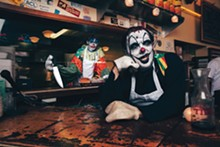 Clowntime is over: Jarome Barideaux (left) and Mike Kitchen working for the man at Sam's Burger Joint.