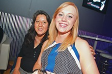 Diana Reyes and Lia Payne enjoy a night at the bar.