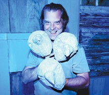 Director Rick Frederick with props