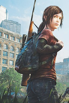 """Ellie and Joel fighting the fungus-infected creatures that """"are not zombies,"""" according to the game's creators."""