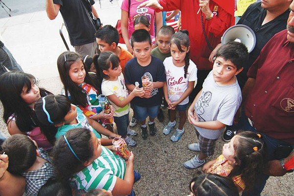 "Families from a north Bexar County community rallied outside the Bexar County jail Friday. Immigrant families in the community claim they've been targeted by a ""rogue sheriff's deputy."" - MICHAEL BARAJAS"
