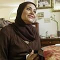 Feature Woman. Muslim. American.