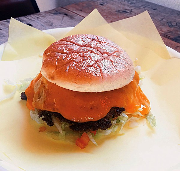 Feeling meat macho? Take it all out on a massive burger. - COURTESY