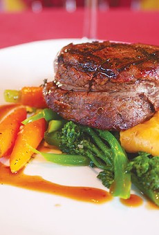 Filet mignon on a bed of vegetables from McCullough Avenue Grill.
