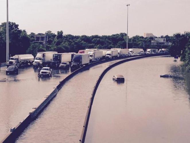 Flood waters this morning on Interstate 45 in Houston. - VIA TWITTER USER @RCROCKER